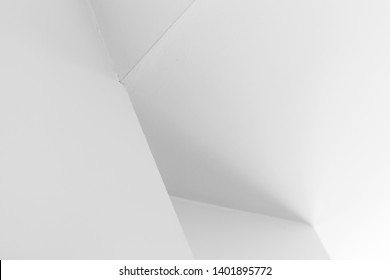 Abstract architecture background, white interior design with corners and soft shadows, black and white photo