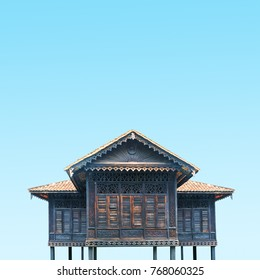 Abstract architecture details of ancient traditional wooden house in Malaysia over blue sky