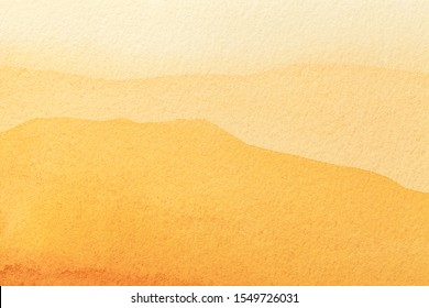 Abstract art background light yellow and golden colors. Watercolor painting on canvas with soft orange gradient. Fragment of artwork on paper with amber pattern. Texture backdrop.