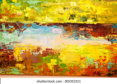 Abstract art background. Oil painting on canvas. Green and yellow texture. Fragment of artwork. Spots of oil paint. Brushstrokes of paint. Modern art. Contemporary art.