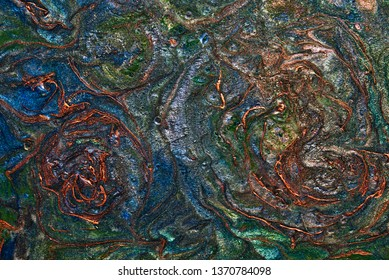 Abstract art with copper, green and blue flowing patterns.