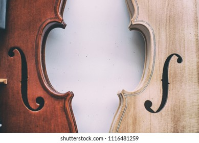 The abstract art design background of raw violin half front side put beside completed violin half front side,blurry light around