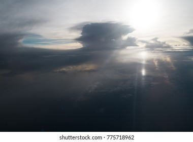 The abstract art design of sky bakground in Morning time,reflection of sunlight is shining to smoky waving cloud,beautiful top view,beauty by nature.