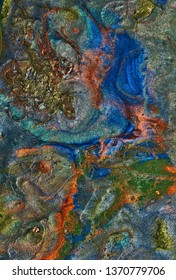 Abstract art with gold, green, orange, and blue flowing patterns.