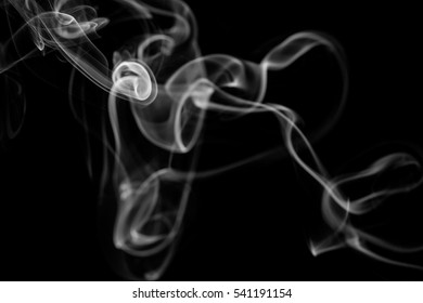 Abstract art. Gray smoke from the incense on a black background. Background for Halloween. Texture fog. Design element. The concept of aromatherapy.