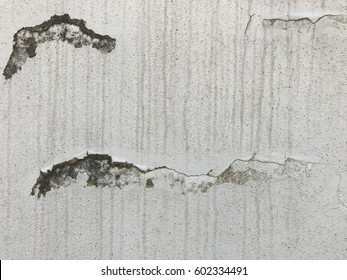 abstract art on white weathered  concrete wall