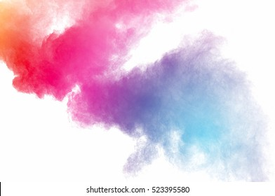 Abstract art powder paint on white background. Movement abstract frozen dust explosion multicolored on white background. Stop the movement of colored powder on white background.