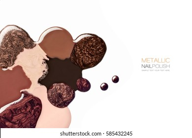 Abstract artistic design of assorted shades of brown and metallic nail polish or varnish in modern beauty fashion colors isolated on white
