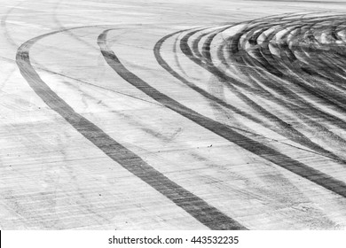 Abstract asphalt road background with crossing tires tracks
