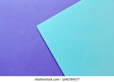 Abstract asymmetric geometric water color paper background in soft pastel purple and blue trend colors.