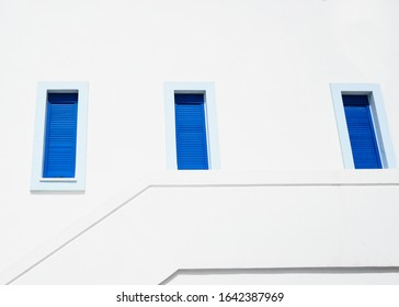 Abstract asymmetric windows in greek colors.