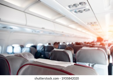 abstract background, airport aircraft cabin, seats with people.