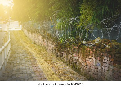 Abstract background of army camp fence with lens flare,  Every cloud has a silver lining, even there are too many wars in this world but world is still lovely home for us