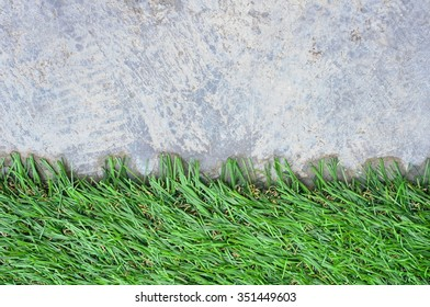 Abstract background with artificial grass on cement floor
