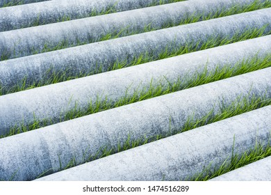 abstract background of asbestos pipes  in the lawn