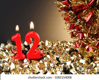 Abstract Background for birthday or anniversary. Red candles showing Nr. 12