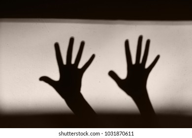 Abstract Background. Black Shadow Of A Big Hand On The Wall. Silhouette Of A Hand On The Wall. Nightmares in Children. Scary Dreams.