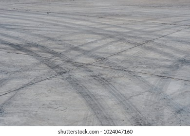 Abstract background black tire tracks on cement floor, Tire trace on the ground, tire marks on cement floor.