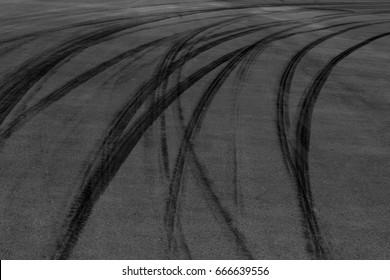 Abstract background black tire tracks skid marks on asphalt road.