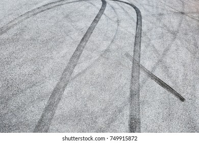 Abstract background black tire tracks skid on asphalt road,high angle shot view in racing circuit