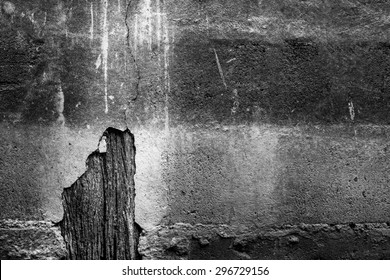 Abstract background in black and white : The hole of old decray wall show old wood in side