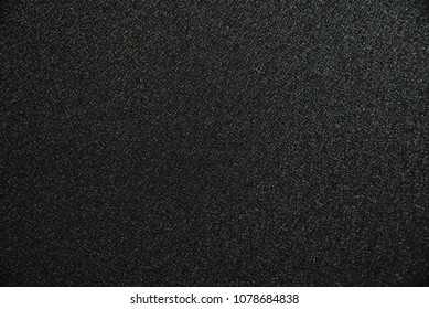 Abstract background from black zinc plate with sunlight in dark tone. Industrial backdrop.