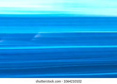 Abstract background of blue neon glowing light shapes. Bright stripes  Can use for poster, website, brochure, print.