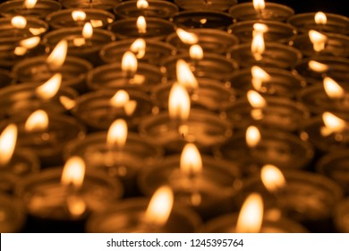 Abstract background of blurred candles in the dark