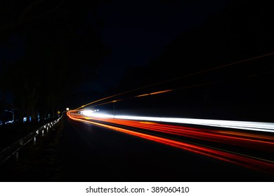 Abstract background of  blurry lighting from cars on main road in dark night:select focus with shallow depth of field:ideal use for background.