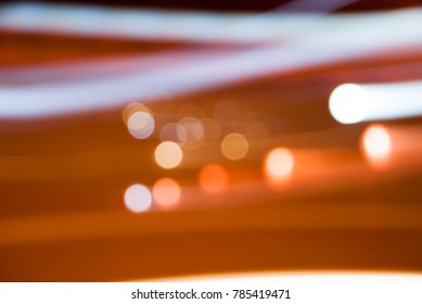 Abstract background with bokeh defocused and speed of lights and shadow taken at the entrance of a fleeting night market in Bangkok,Thailand with copy space.