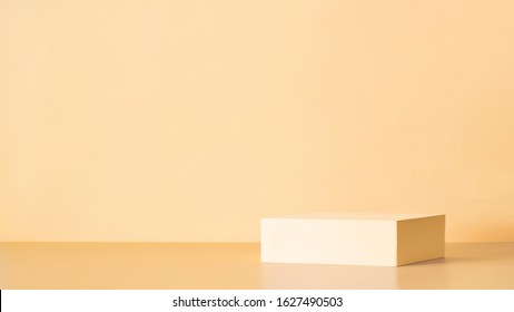 Abstract background for branding, identity and packaging presentation. Light yellow podium on cream yellow paper background. Copy space for text, design or mock up product. Banner