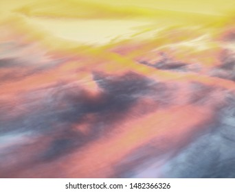 Abstract background in bright yellow, pink, and blue pastel colours. Image reworked from originally being a sky with clouds and sunset into an abstract futuristic landscape.