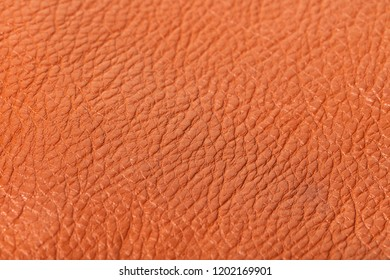 abstract background of brown leather texture closeup