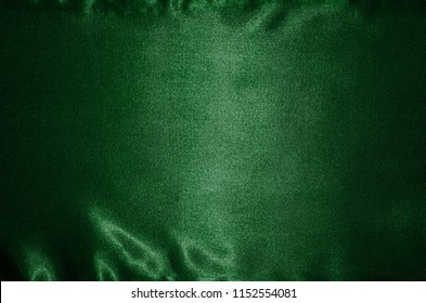 Abstract Background by deep green fabric, Wallpaper and texture by textile deep green, Top view and wave of stripe fabric.