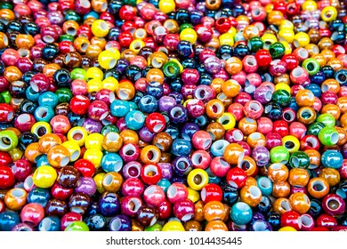 Abstract background of close up multi colored beads.