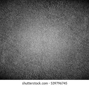 Abstract background of closeup asphalt dark black texture with rock uneven surface on urban empty street outdoor Perspective wide angle view to new road hard structure macro detail, industrial pattern