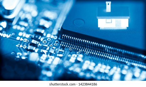 Abstract background of close-up details of electronic cpu chip with glowing house icon, concept of modern security technology for smart home.