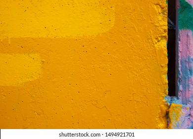 Abstract background. Closeup fragment of cracked and peeling painted wall.
