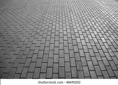 abstract background of cobble stone road making from cement blocks