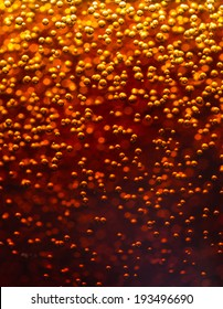 Abstract background. Cola. Carbon dioxide bubbles. Macro photo.