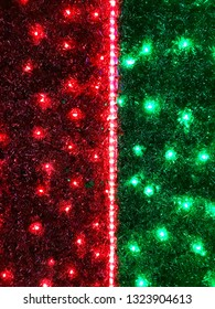 Abstract background of colored luminous Christmas garlands.