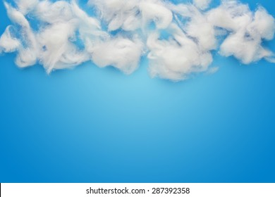 abstract background composed of white cotton wool clouds over blue.