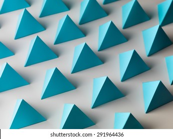 abstract background consisting of blue pyramid paper shapes