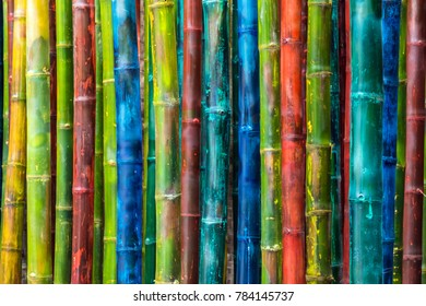 Abstract background created from bamboo painted artistically in different colors.