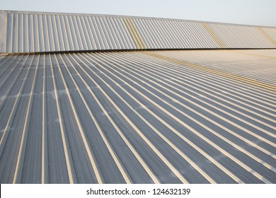 abstract background created by the surface of a metal roof industrial