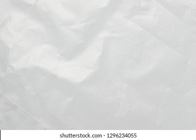 Abstract background crumpled plastic film texture white garbage bag