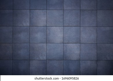 Abstract background from dark gray tiles