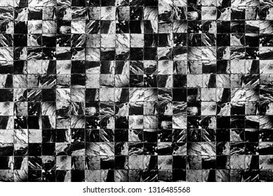 Abstract background from dark marble pattern on wall.