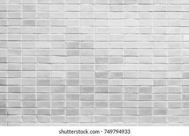 Abstract background from decorated grey bricks mosaic tiles on wall. Vintage and retro background.