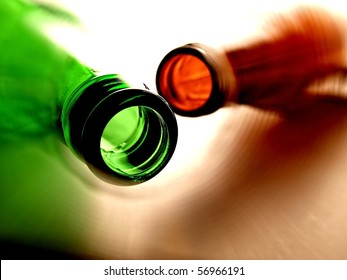 Abstract background design made up of different colored  empty  beer bottles.